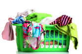 Clothes in green plastic basket isolated on white — Stok fotoğraf