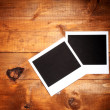 Photo papers on wooden background — Foto Stock