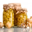Delicious marinated mushrooms in the glass jars and raw champignons isolate - Zdjęcie stockowe