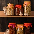 Delicious marinated mushrooms in the glass jars, raw champignons and oyster - Zdjęcie stockowe