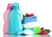 Detergent with washing powder and towels isolated on white — Stock Photo