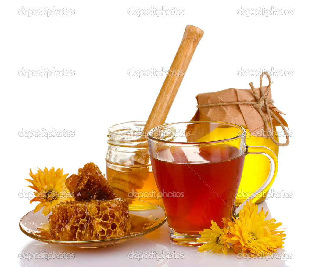 Honey, lemon, honeycomb and a cup of tea isolated on white — Stock Photo #8241084