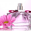 Women's perfume in beautiful bottle and flower isolated on white — Stock Photo