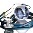 Globe and stethoscope isolated on white — Stock Photo #8255771