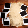 Photo papers with old paper on wooden background — ストック写真