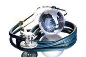 Globe and stethoscope isolated on white — Stock Photo