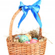 Colorful Easter eggs in the basket with a blue bow isolated on white — Stock Photo #8271443