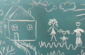 Blackboard with drawing happy family with house closeup — Stock Photo