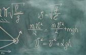 Formulas written on green chalkboard — Stock Photo