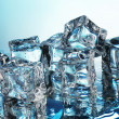 Melting ice cubes on blue background — Foto Stock