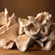 Oyster mushrooms wooden table on brown background - Lizenzfreies Foto