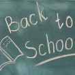 Back to school written on green chalkboard — Stock Photo