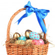 Colorful Easter eggs in the basket with a blue bow isolated on white — Stock Photo #8281200