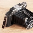 Old photo camera on wooden background — Stock Photo