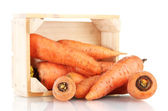 Raw carrots in wooden box isolated on white — Stock Photo