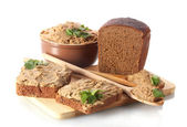 Fresh pate with bread on wooden board isolated on white — Stock Photo