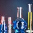 Test-tubes on blue-red background — Stock Photo