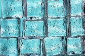 Melting ice cubes on blue closeup — Stock Photo