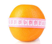 Orange and measuring tape isolated on white — Stock Photo