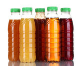 Bottles with juice isolated on background — Stock Photo
