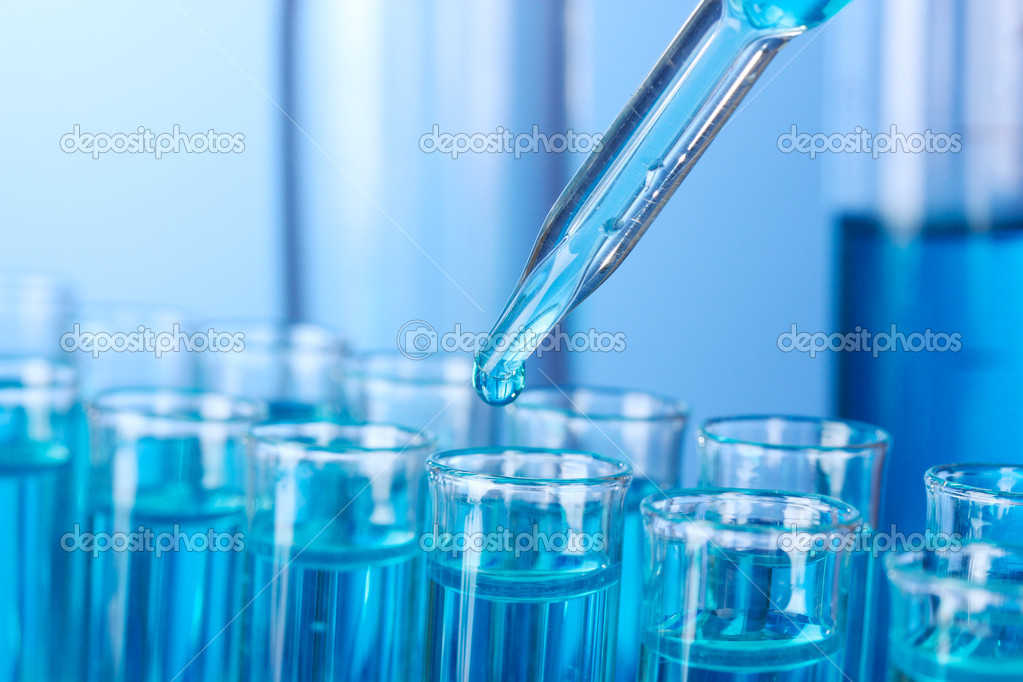 Test-tubes on blue background  Stock Photo #8328518