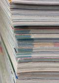 Stack of magazines isolated on white — Stock Photo