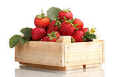 Strawberries with leaves in wooden box isolated on white — Stock Photo