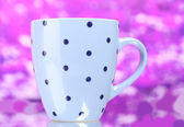 Сolor cup on pink background — Stock Photo