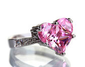 Beautiful ring with pink gem isolated on white — Stock Photo