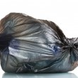 Black garbage bag with trash isolated on white — Stock Photo