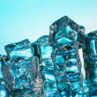 Melting ice cubes on blue background — 图库照片