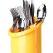 Kitchen cutlery, knives, forks and spoons in yellow stand isolated on white - Stock Photo