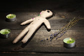 Voodoo doll boy on a wooden table in the candlelight — Стоковое фото
