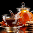 Glass teapot and cup with black fruit teand cookies isolated on white — Stock Photo #8422950
