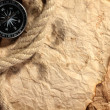 Old paper, compass and rope on a wooden table - Foto Stock