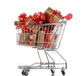 Beautiful golden gifts with red ribbon in shopping cart isolated on white — Stock Photo