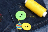 Rhomb-shaped patch on jeans with threads and buttons closeup — Stock Photo