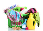Clothes with detergent and washing powder in green plastic basket isolated — Stock Photo