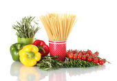 Spaghetti and rosemary in cups, paprika, tomatoes cherry and green onion is — Stock Photo