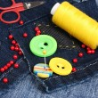 Rhomb-shaped patch on jeans with threads and buttons closeup — Lizenzfreies Foto