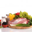 Raw meat and vegetables on a wooden board isolated on whitе - Foto Stock