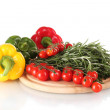 Fresh green rosemary, paprika and tomatoes cherry on wooden board isolated - Foto Stock