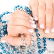 Hands with beautiful winter design and beads isolated on white - Foto Stock