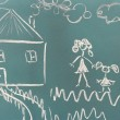 Blackboard with drawing happy family with house closeup - ストック写真