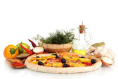 Delicious pizza, vegetables, spices and oil isolated on white — Stock Photo