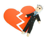 Voodoo doll boy-groom on the broken heart isolated on white — Stock Photo