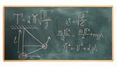 Formulas written on green chalkboard — Stock Photo