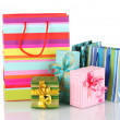 Bright gift bags and gifts isolated on white — Stock Photo #8519025