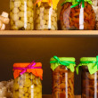 Delicious marinated mushrooms in the glass jars, raw champignons and oyster - Stock Photo
