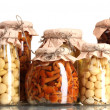 Delicious marinated mushrooms in the glass jars isolated on white - Stock Photo